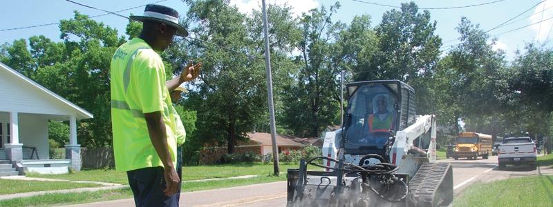 man-guiding-truck